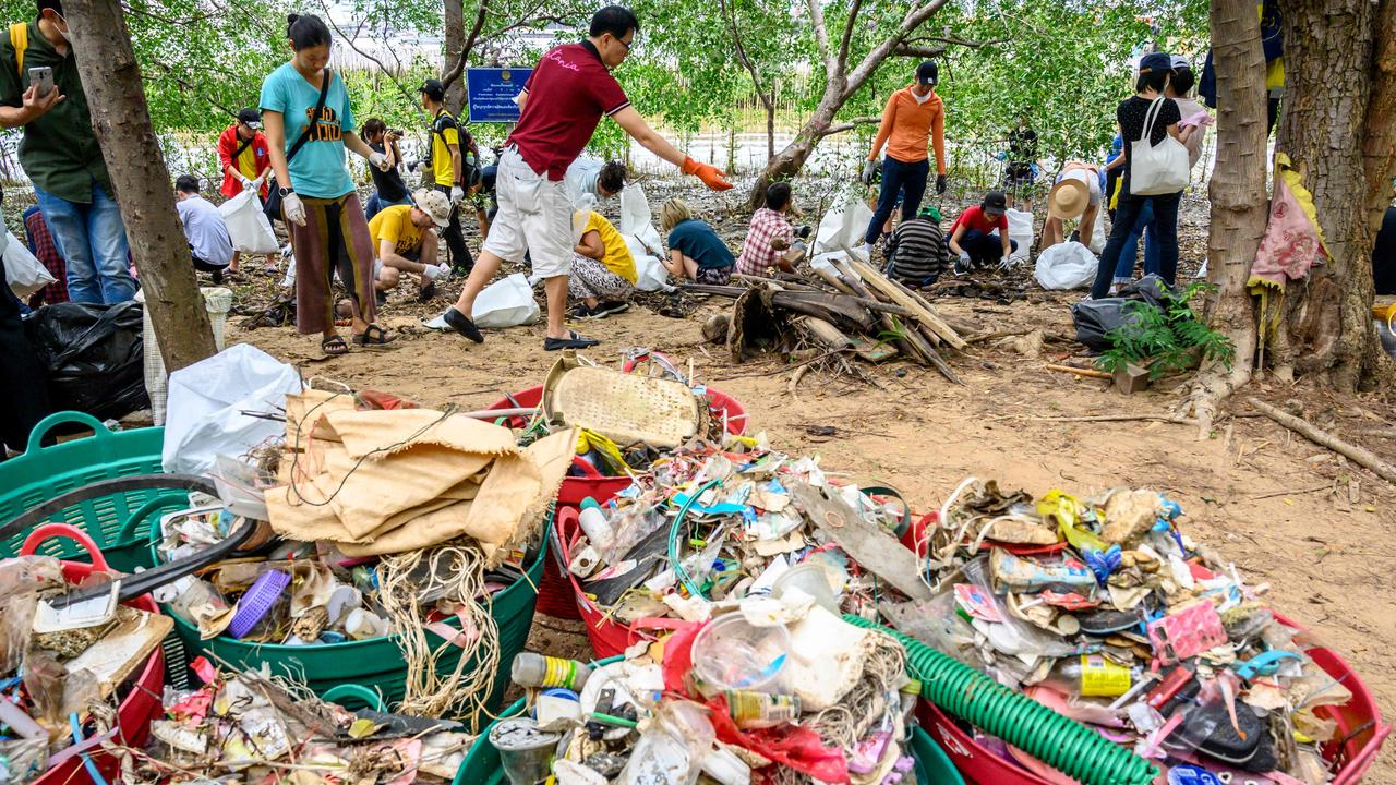 Volunteers collect plastic as part of Trash Hero event in Bangkok, Thailand on August 25. Hundreds of people gathered on the bank of the Chao Praya river to clean it from the tons of plastic waste carried by the current. Picture: AFP