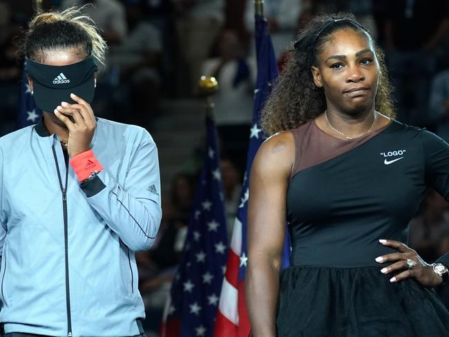 Serena Williams and US Open champ Naomi Osaka during the awkward presentation ceremony. Picture: AFP