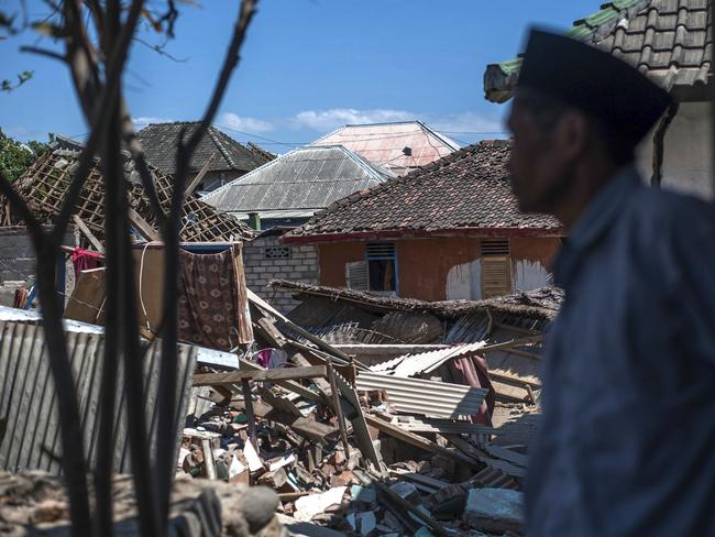 An Indonesian man inspects the damage in a village from a major earthquake in Kayangan on Lombok. Picture: AP