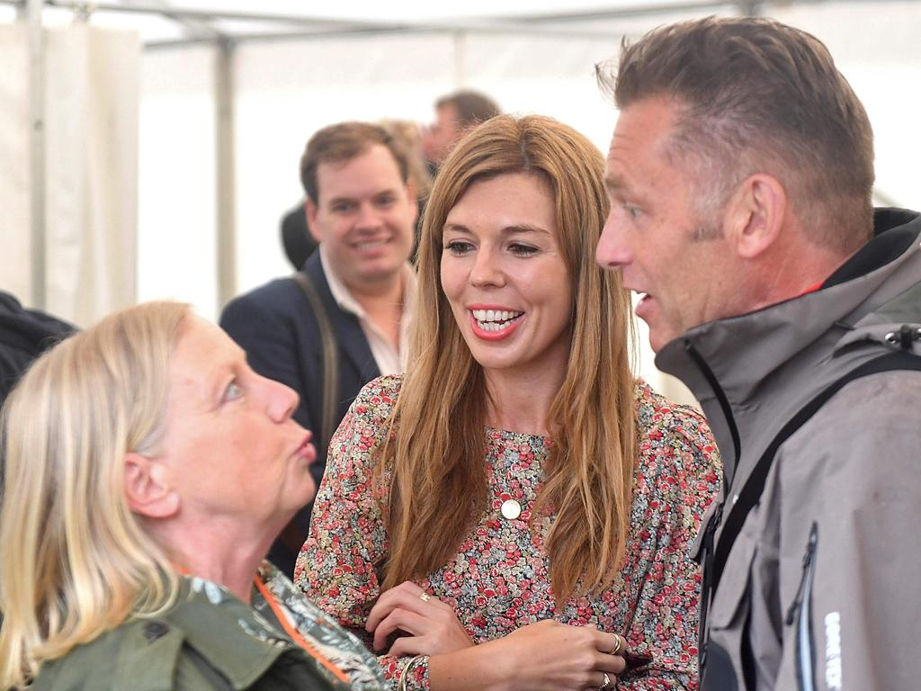Carrie Symonds (C), girlfriend of Britain's Prime Minister Boris Johnson, chats at Birdfair, an environmental awareness conference. Picture: AFP