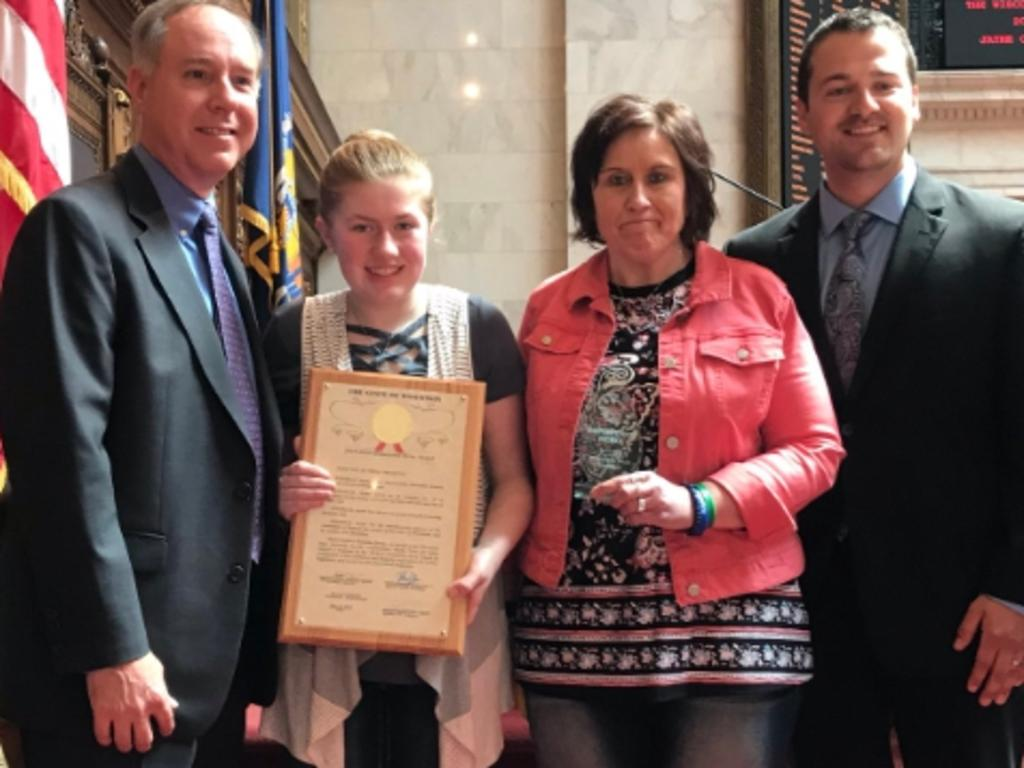 Jayme, pictured with her aunt Jennifer, receives a bravery award from the FBI. Picture: Supplied