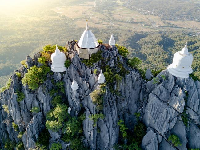 3. SEE THAILAND'S FLOATING PAGODAS These otherworldly white pagodas seem to hover mystically from their perch high on the mist-shrouded peaks. Though their origins may look supernatural, the floating pagodas of the Wat Chaloem Phra Kiat temple in Northern Thailand started life via the very hike one takes to reach them — monks painstakingly carried up every slab of material to build the structures.