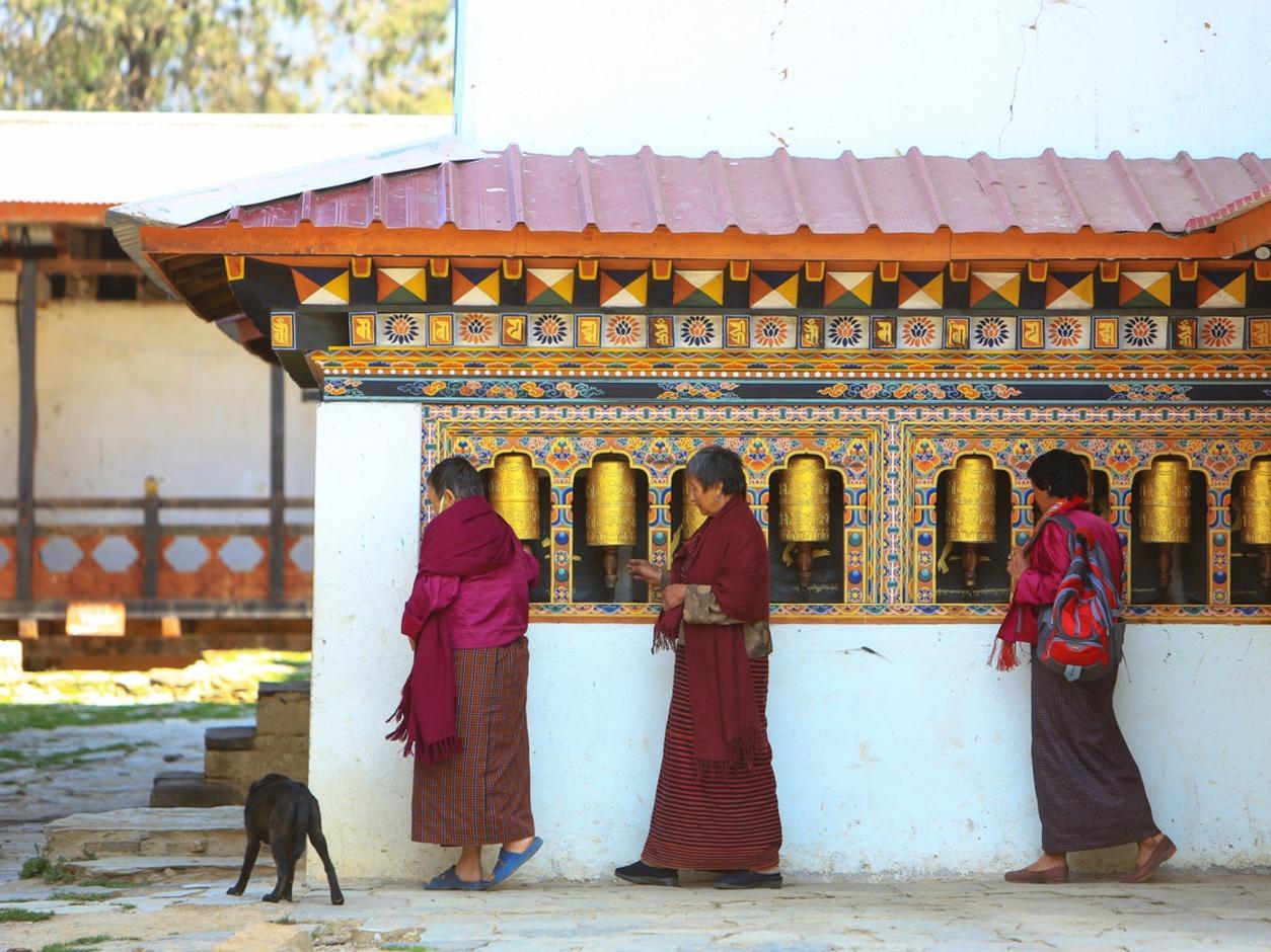Women turning prayer wheels in the Gangteng Monastery in the Phobjikha Valley, Bhutan