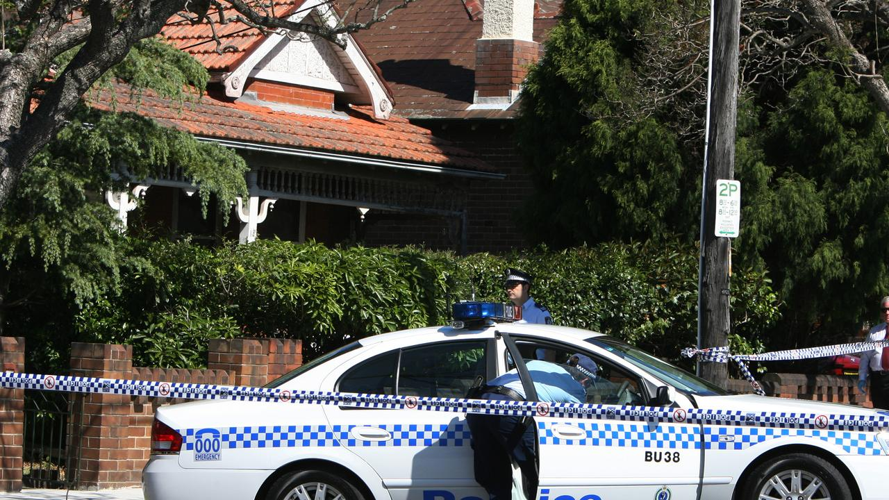 Police stand outside the Worrall house in Strathfield, in Sydney's west on the day of the horrific stabbing. Picture: Jenny Evans