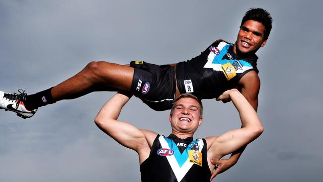 Sky's the limit: Ollie Wines gives fellow youngster Jake Neade a lift. Picture: Sarah Reed.