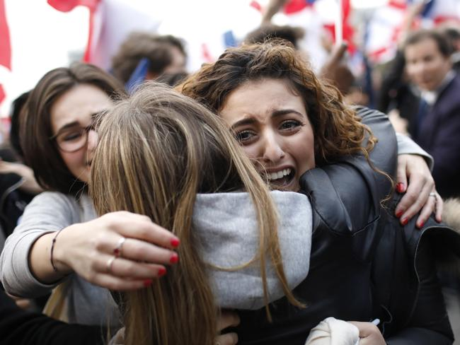 Supporters of independent candidate Emmanuel Macron react outside the Louvre Museum in Paris. Picture: Laurent Cipriani
