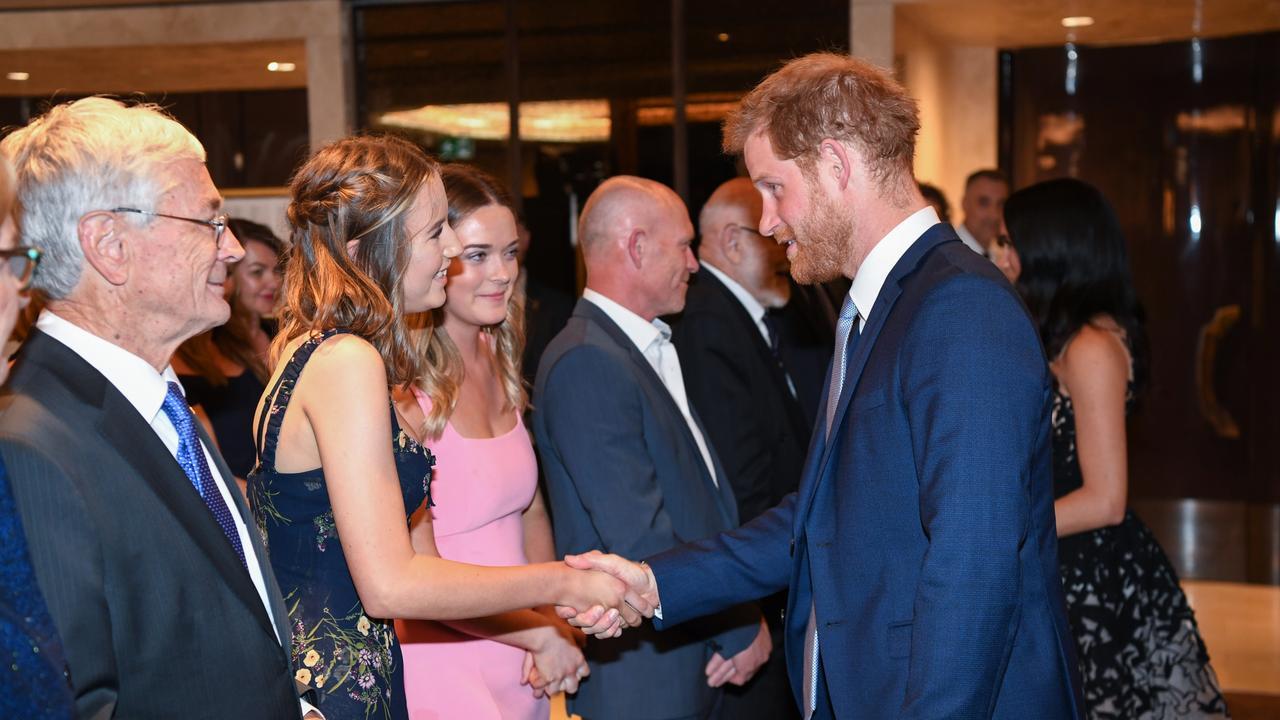 Sophia Skarparis shakes hands with Prince Harry.