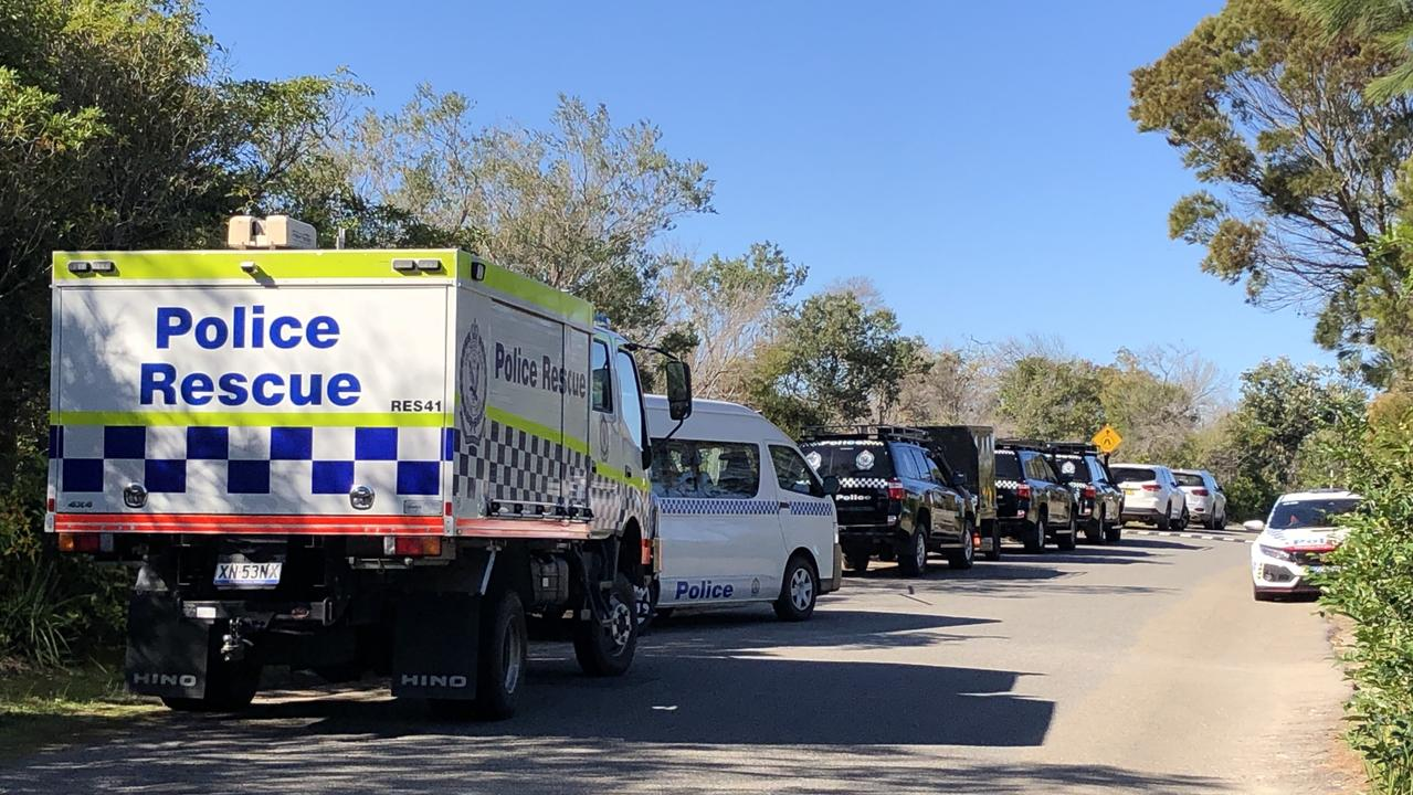 Police vehicles at the Blue Fish Point search location today. Picture: Jim O'Rourke