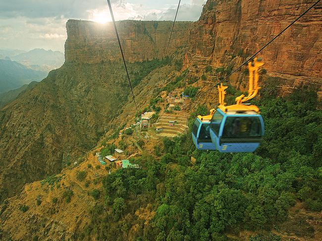 Visitors can take a cable car over the Asir Mountains' green valleys and villages, while keeping a look out for the area's wildlife — eagles above, and Hamadryas baboons below. Picture: SCTH