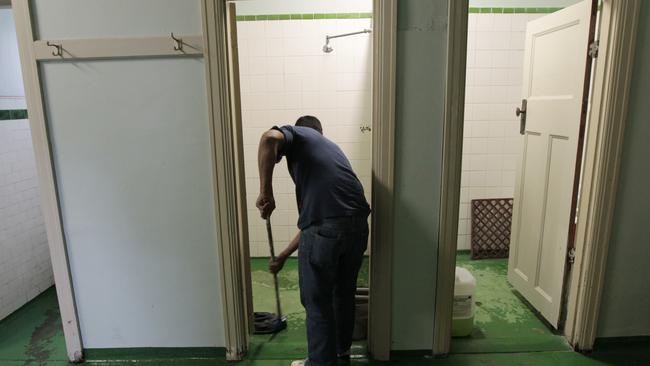 Adrian cleans one of the bathrooms inside the Gatwick Hotel which has been sold and will close its doors in 2017.