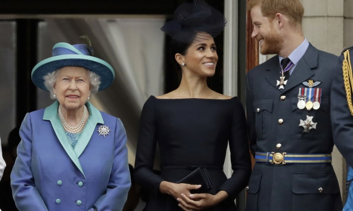 FILE - In this Tuesday, July 10, 2018 file photo Britain's Queen Elizabeth II, and Meghan the Duchess of Sussex and Prince Harry watch a flypast of Royal Air Force aircraft pass over Buckingham Palace in London. Prince Harry and Meghan Markle are to no longer use their HRH titles and will repay £2.4 million of taxpayer's money spent on renovating their Berkshire home, Buckingham Palace announced Saturday, Jan. 18. 2020. (AP Photo/Matt Dunham, File)