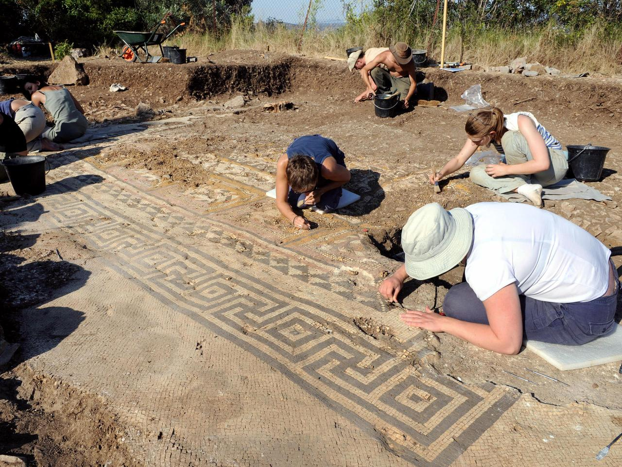 Archaeology students work on a six metre squared mosaic dating from 50 BC on July 30, 2008 near Ales. This mosaic, exceptional due to its size and multicoloured motifs was discovered during digs on a hill overlooking the town. AFP PHOTO PASCAL GUYOT