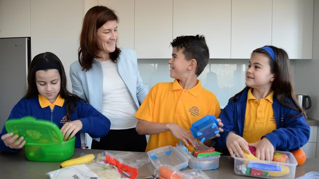 Rebecca Nash, with Scarlet, 5, Max, 10, and Ava, 8, always makes sure her children are given healthy school lunches but admits they are allowed a treat or two occasionally. Picture: ELENOR TEDENBORG