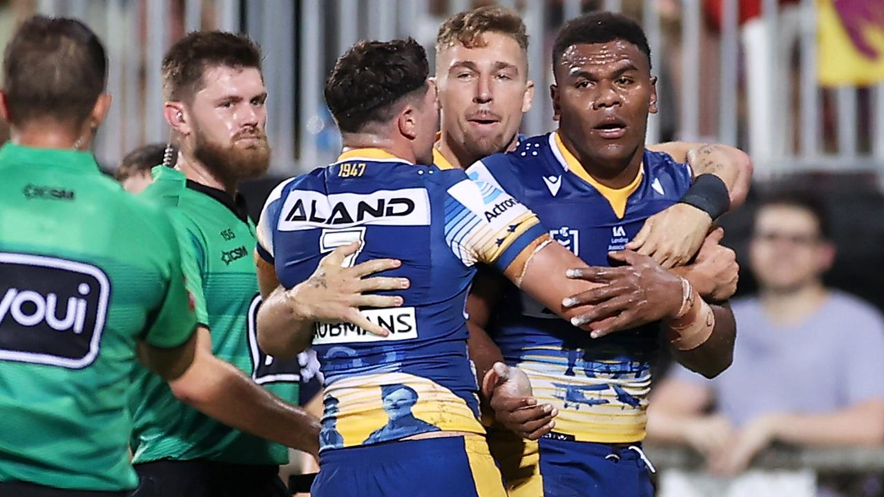 Maika Sivo of the Eels celebrates with his teammates after scoring a try.