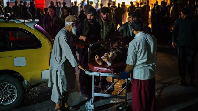 The death toll has risen to at last 95 and hundreds more are wounded after a suicide bombing outside Kabul's crowded international airport on Thursday (local time). Picture: Getty Images