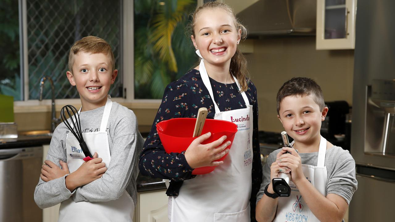 Lucinda Gabb, 11, with nine-year-old twin brothers Elliot (left) and Lincoln (right) run their own baking business Kids Rock the Kitchen. Picture: AAP/Josh Woning