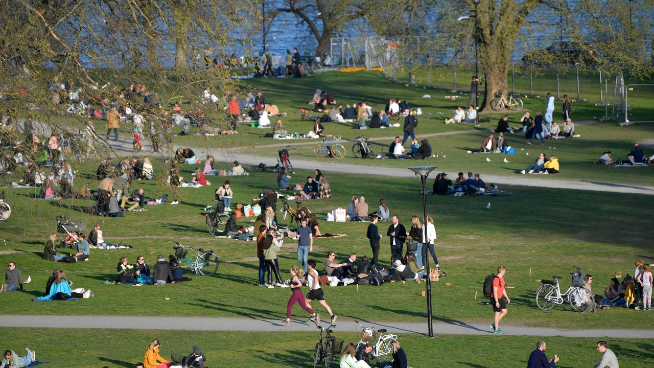 People enjoy warm and spring-like weather with high temperatures in Stockholm. Picture: AFP