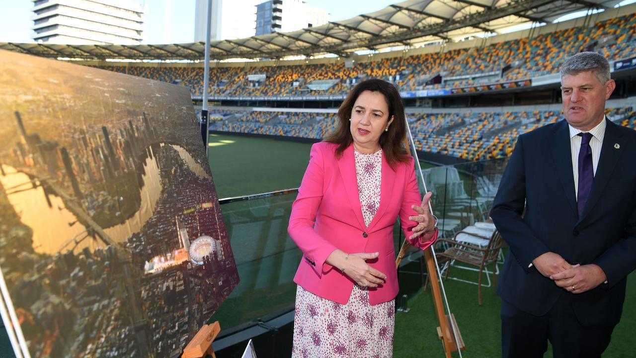 QLD Premier Annastacia Palaszczuk and Minister for Sport Stirling Hinchliffe look at artist impressions for a complete rebuild of the Gabba, the proposed main stadium should Queensland host the 2032 Olympic and Paralympic Games. Picture: NCA NewsWire / Dan Peled
