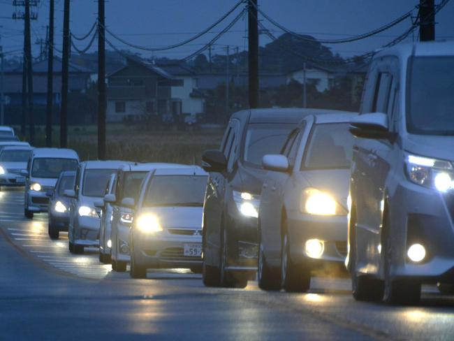 Vehicles make a line as they flee following a tsunami warning in Iwaki, Fukushima prefecture early Tuesday morning. Picture: Kyodo News via AP