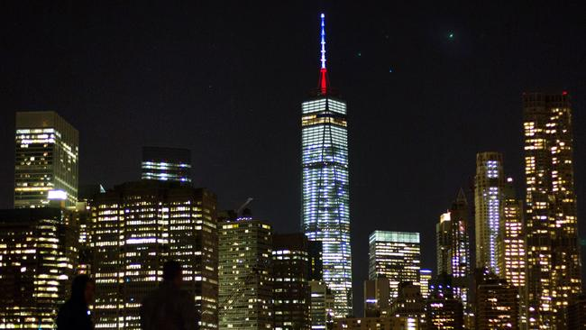 The One World Trade Center spire is lit blue, white and red. Picture: AP/Kevin Hagen