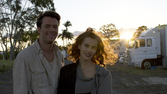 Thomas Cocquerel and Isabel Lucas on the Gold Coast set of In Like Flynn, directed by Russell Mulcahy. Picture: Supplied/Gary McDonald