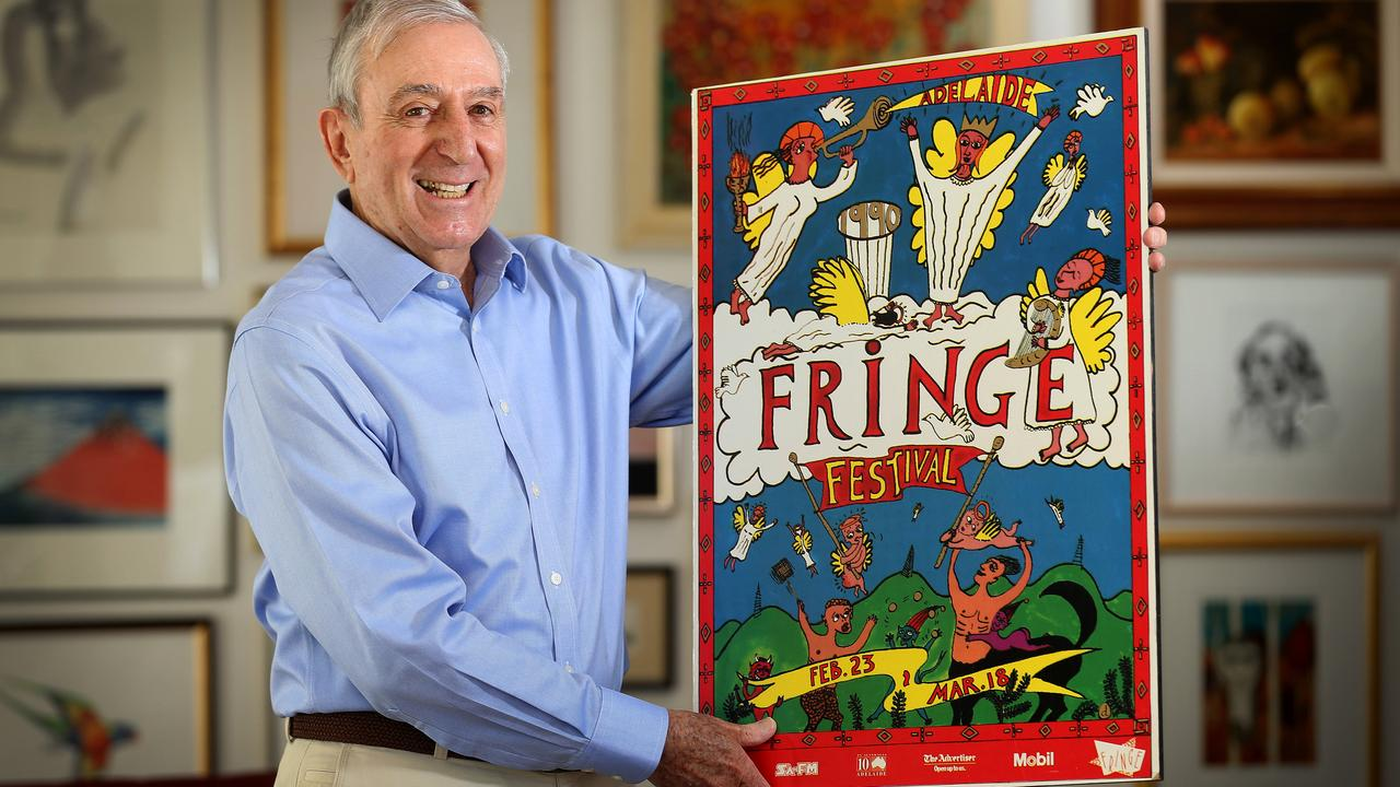 Fringe founder Frank Ford, pictured in 2014 with the original Fringe poster from 1990 by artist Driller Jet Armstrong. Picture: Dean Martin