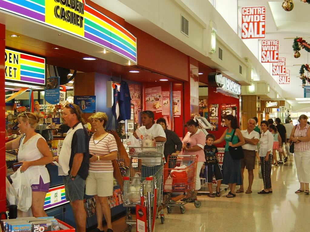 People queue up at the Willows Nextra newsagency to get their ticket in 2004.