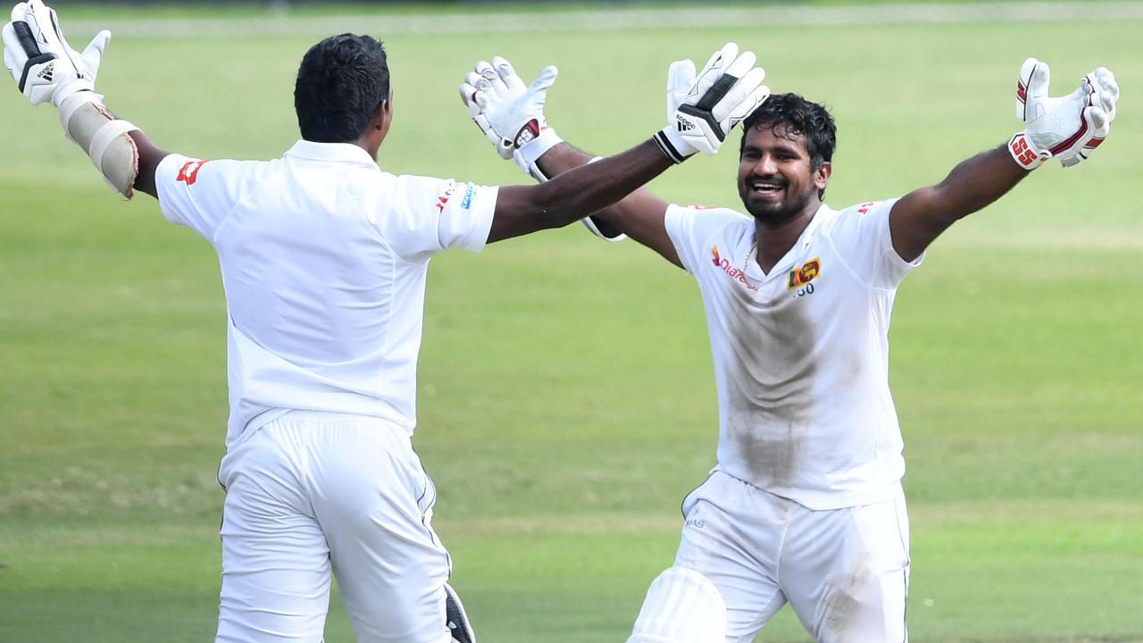 Vishwa Fernando and Kusal Perera celebrate one of Test cricket's biggest underdog wins.