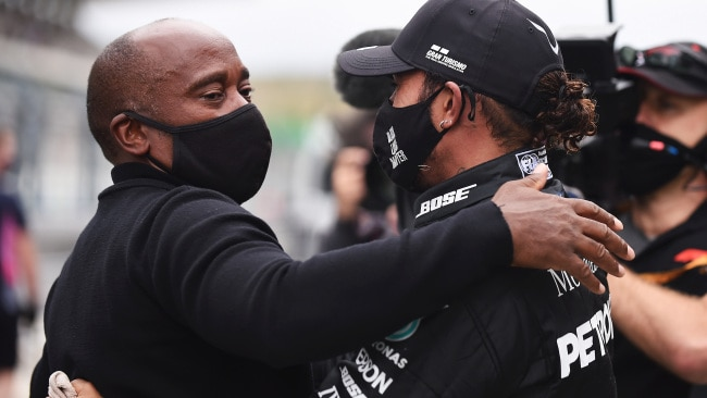 Lewis Hamilton hugs his father Anthony after making history.