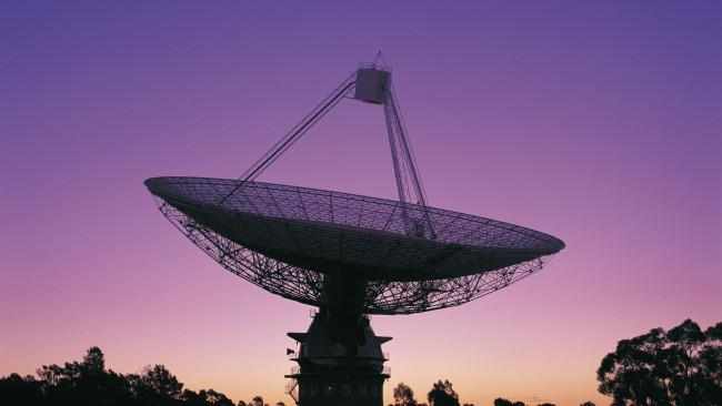 The CSIRO Radio Telescope at Parkes at twilight with pink-purple sky, with new antenna, Central NSW