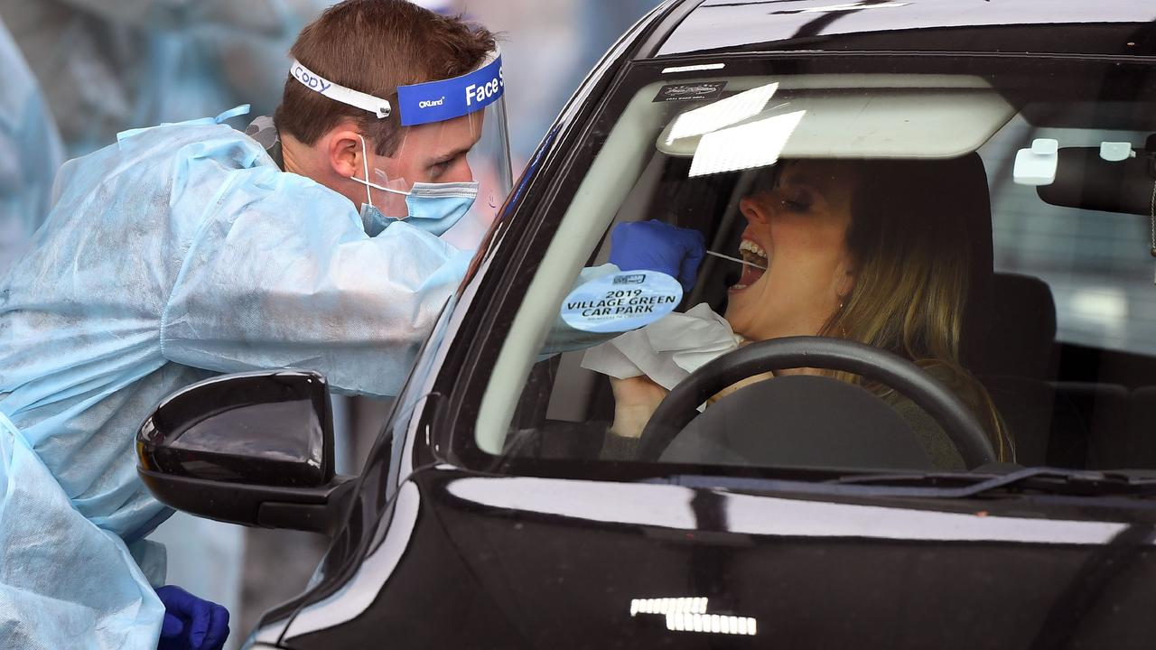 A member of the Australian Defence Force takes a swab sample at a drive-through COVID-19 coronavirus testing station in the Melbourne suburb of Fawkner. Photo: William WEST / AFP.