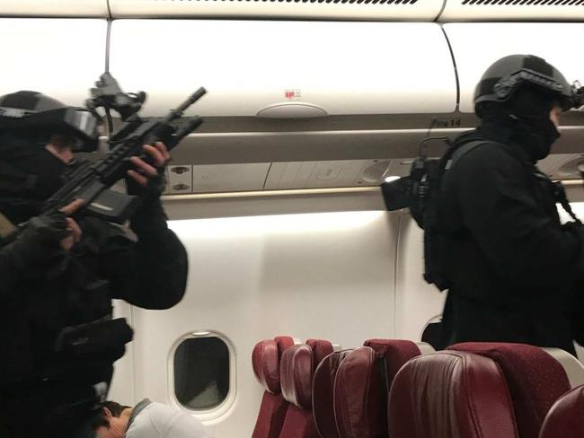 The scene that confronted passengers soon after landing back in Melbourne. Picture: Andrew Leoncelli