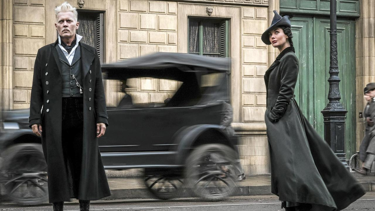 Johnny Depp and Poppy Corby-Tuech in a scene from the movie <i>Fantastic Beasts: The Crimes of Grindelwald</i>. Picture: Jaap Buitendijk.
