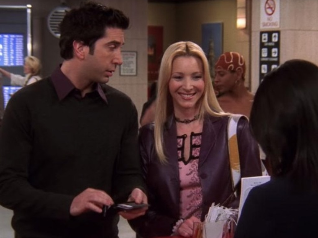 Take note of the woman behind Phoebe.