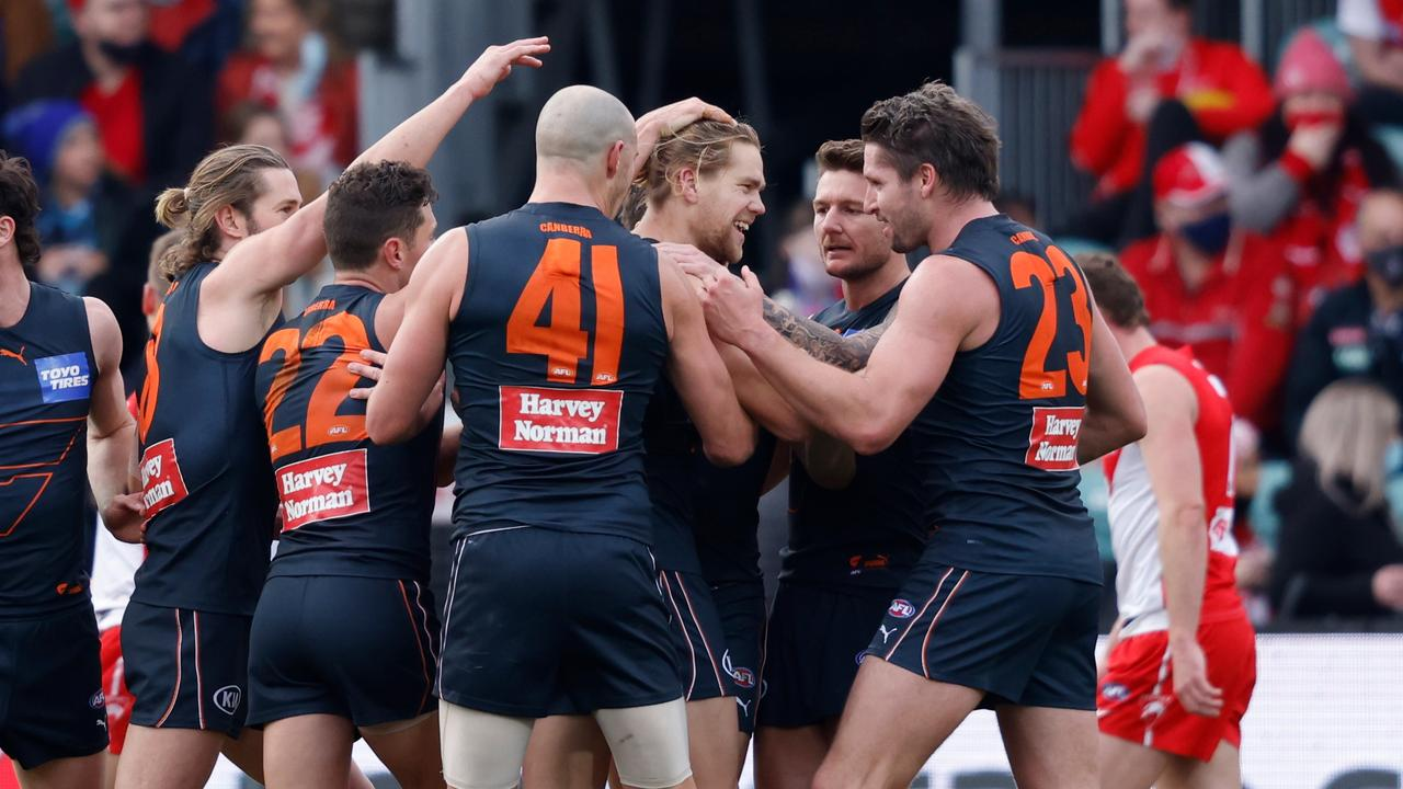 LAUNCESTON, AUSTRALIA - AUGUST 28: Harry Himmelberg (C) of the Giants celebrates a goal with his teammates during the 2021 AFL Second Elimination Final match between the Sydney Swans and the GWS Giants at University of Tasmania Stadium on August 28, 2021 in Launceston, Australia. (Photo by Rob Blakers/Getty Images)