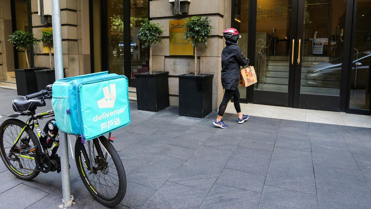 A food delivery rider drops off food at a Sydney quarantine hotel. Picture: NCA NewsWire / Gaye Gerard