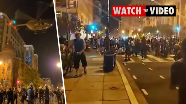 Military helicopters hover over protesters in Washington after 'mandatory curfew'