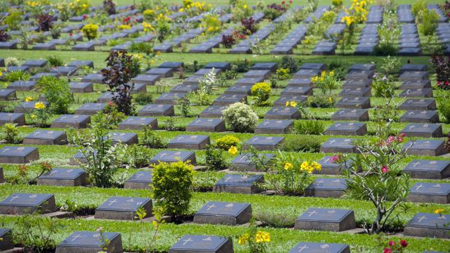 Kanchanaburi, Thailand - August 5, 2007: Kanchanaburi War Cemetery, the burial place in Thailand of POWs who died building the Death Railway during World War II.