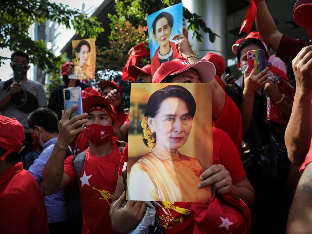 People hold up images of Myanmar's de facto leader Aung San Suu Kyi at a protest outside Myanmar's embassy in Bangkok, Thailand. Picture: Lauren DeCicca/Getty Images