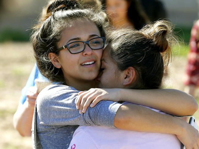 Relief ... A mother and daughter reunite. Picture: Matt York/AP