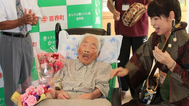 This picture received from Kikaicho Town Hall via Jiji Press and taken on September 18, 2017 shows 117-year-old Nabi Tajima (2nd L) in Kikaicho on Kikai island of Kagoshima prefecture. A 117-year-old Japanese woman, thought to be the world's oldest person, has died, a local official told AFP on April 22, 2018. Nabi Tajima, who was born August 4, 1900, died around 8:00 pm (1100 GMT) on April 21 at a hospital on her native Kikai Island in Kagoshima region, according to Susumu Yoshiyuki, a health and welfare official. / AFP PHOTO / KIKAI TOWN VIA JIJI PRESS / JIJI PRESS / Japan OUT
