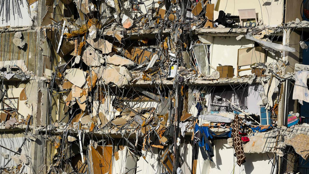 Rubble hangs from a partially collapsed building in Surfside north of Miami Beach. Picture: Eva Marie UZCATEGUI / AFP