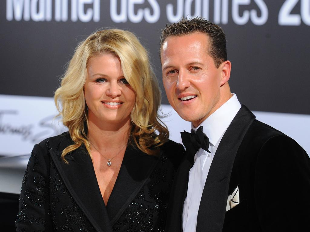 Formula-One driver Michael Schumacher and his wife Corinna arrive for the GQ gala 'Men of the Year' in Berlin on October 29, 2010.  AFP PHOTO / JENS KALAENE  GERMANY OUT / AFP PHOTO / DPA / JENS KALAENE