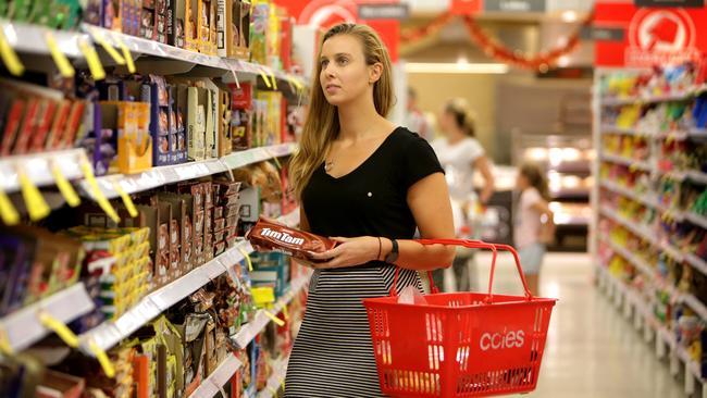 26/11/2015: Sarah Blake browses through the Tim Tam varieties at Coles Taronga Village store. Stuart McEvoy for The Australian.