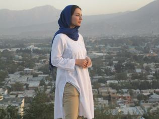 Afghan-born Ms Hakim fled the country on foot with her family to Pakistan where they lived for two years before being adopted by a NSW family. She studied journalism and moved to the UK to work for the BBC. Picture: Supplied