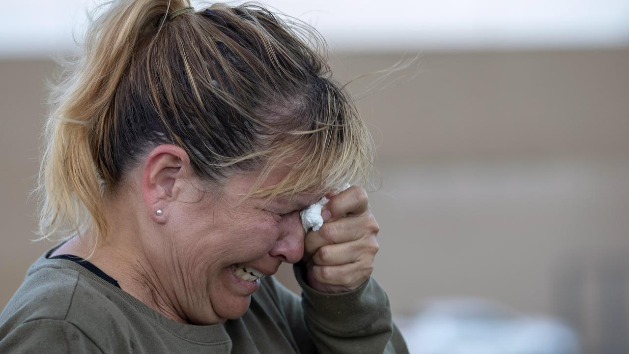 Edie Hallberg cries while speaking to police outside a Walmart store where a shooting occurred earlier in the day as she looks for her missing mother Angie Englisbee. Picture: AP