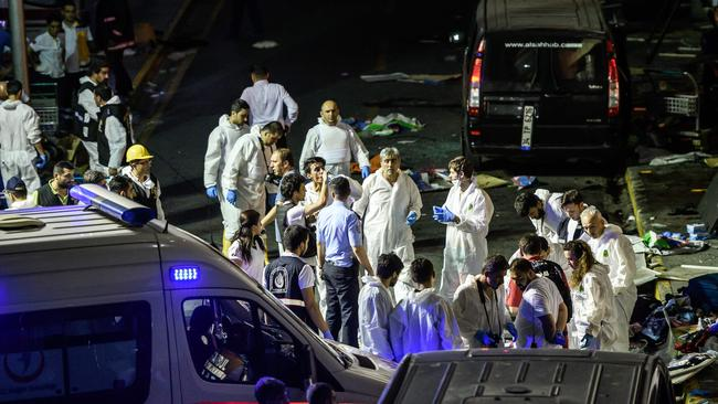 Forensic police work the explosion site at Ataturk airport. Picture: AFP/OZAN KOSE