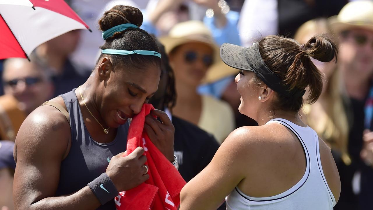 Canada's Bianca Andreescu, right, consoles Serena Williams. (Frank Gunn/The Canadian Press via AP)