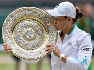 LONDON, ENGLAND - JULY 10: Ashleigh Barty of Australia celebrates with the Venus Rosewater Dish trophy after winning her Ladies' Singles Final match against Karolina Pliskova of The Czech Republic  on Day Twelve of The Championships - Wimbledon 2021 at All England Lawn Tennis and Croquet Club on July 10, 2021 in London, England. (Photo by AELTC/Simon Bruty - Pool/Getty Images)
