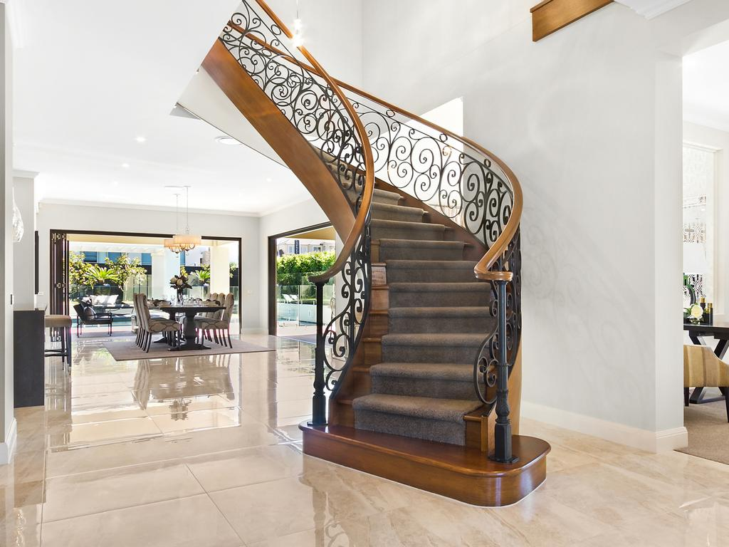 The home features a sweeping staircase